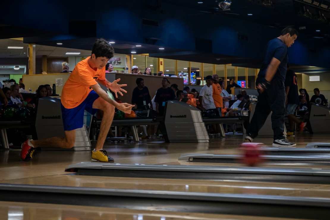 A participant rolls a bowling ball during the Special Olympics Hawaii Holiday Classic State Games on Marine Corps Base Hawaii Nov. 23.