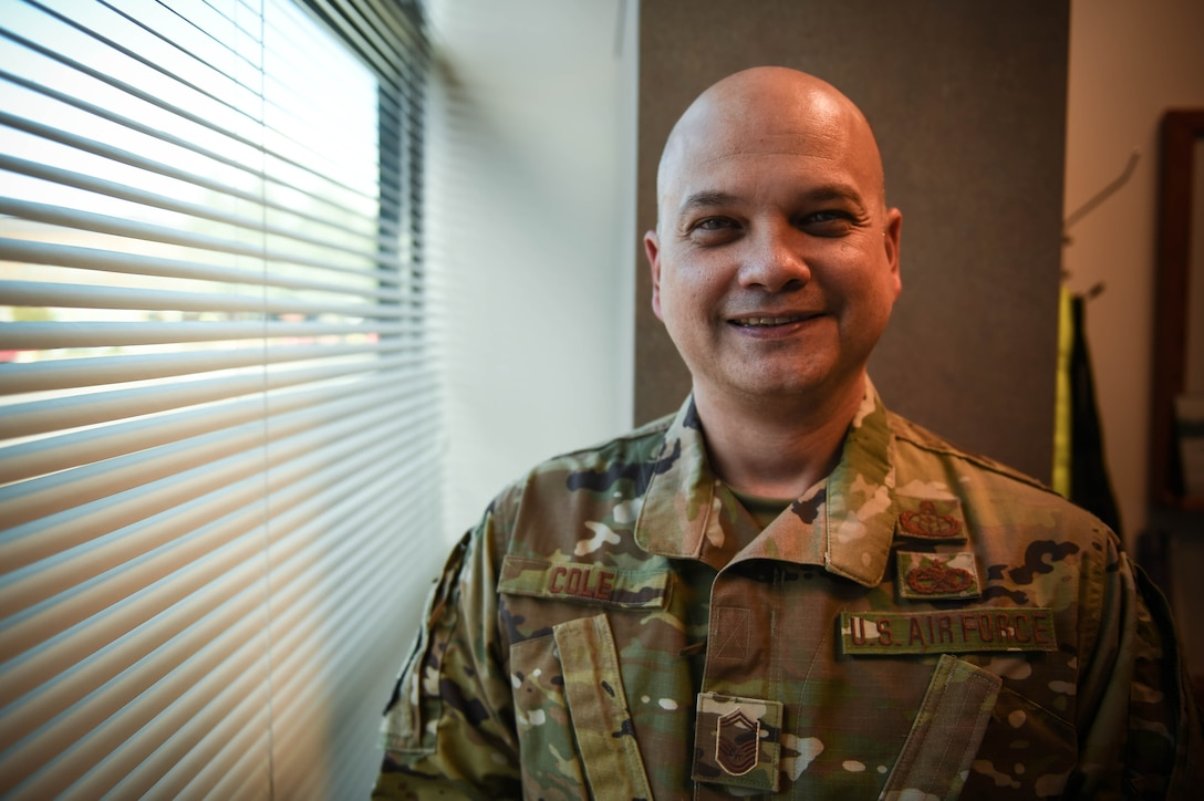 """Senior Master Sgt. Samuel Cole, 62nd Operations Support Squadron superintendent, poses for a photo on Joint Base Lewis-McChord, Wash., Nov. 25, 2019. He was one of the ten McChord Airmen selected this year for promotion to chief master sergeant, the highest enlisted rank in the Air Force.   """"It is a huge honor and a privilege to be selected for this promotion and I intend to continue taking care of my people and aim toward affecting change. A good piece of mentorship that I received was to focus more on being effective and less on being right in most situations that you encounter. Chief master sergeant it is a great milestone and I will work hard to live up to the honor and take care of the Airmen of which I am charged.""""  (U.S. Air Force photo by Airman 1st Class Mikayla Heineck)"""