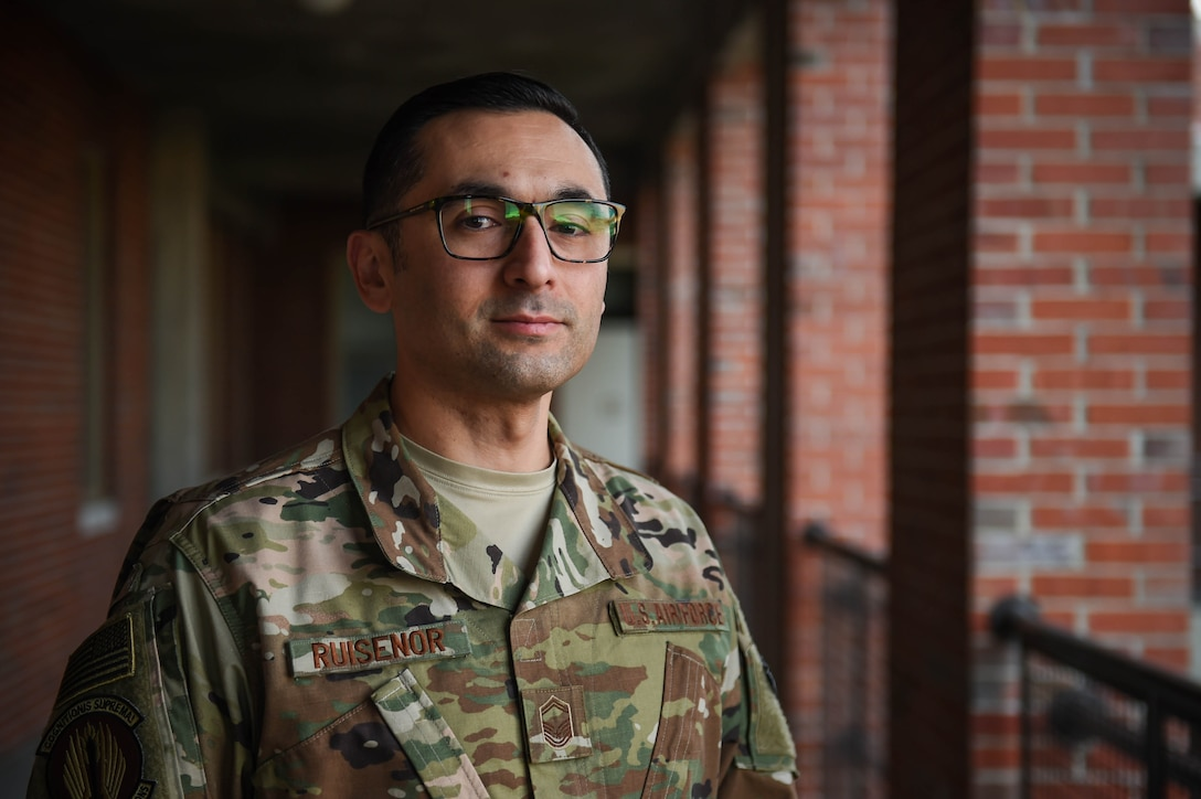 """Senior Master Sgt. Adrien Ruisenor, 62nd Maintenance Group Quality Assurance superintendent, poses for a photo on Joint Base Lewis-McChord, Wash., Nov. 26, 2019. He was one of the nine McChord Airmen selected this year for promotion to chief master sergeant, the highest enlisted rank in the Air Force.  """"I am excited about the possibilities this promotion brings and the changes that it will allow me to make. To me, it shows that you don't have to have this dream or goal of progressing through the ranks, you can just work hard at your job, and take care of your people, and that's enough. The Air Force will notice your worth. A piece of mentorship given to me was 'you're not so important that the Air Force is going to stop without you, so do the best that you can while you're still a part of it.' This one hit me hard as a young non-commissioned officer who thought he was hot stuff, but it really opened my eyes. It doesn't matter where you get moved to. The Air Force is full of high potential Airmen, and one of them is going to step up and fill the void. You had your opportunity and you should have made it as good as possible for the next guy.  I am so proud of all my teams, troops, and teammates. I don't know why I was so lucky, or how it happened, but my teams were always the most cohesive and hardest working people, and just plainly the best at what they did. They all have been a part of this and I am so proud that we have always been able to come together and make it happen. Thank you to everyone.""""  (U.S. Air Force photo by Airman 1st Class Mikayla Heineck)"""