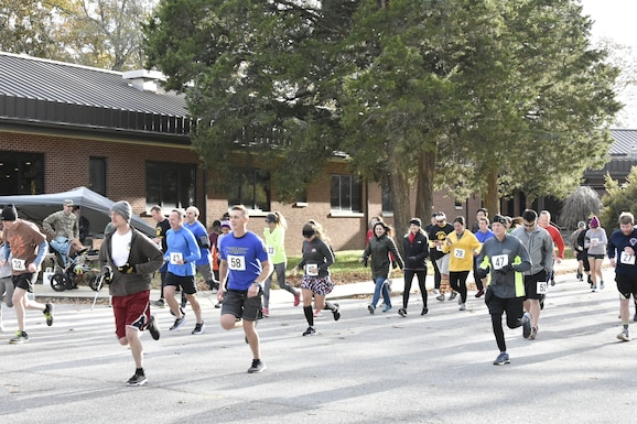 Runners depart the starting line during the 34th annual AEDC Turkey Trot, Nov. 15 at the Arnold Lakeside Center, Arnold Air Force Base. More than three dozen runners and walkers attended the event. (U.S. Air Force photo by Bradley Hicks)