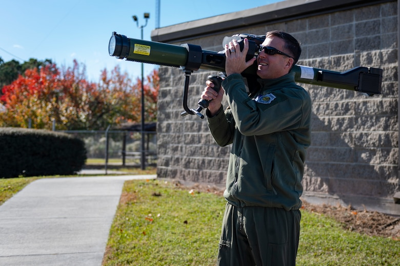 A photo of Col. Dan Walls looking through the sights of an MPAD during a 23d OSS immersion