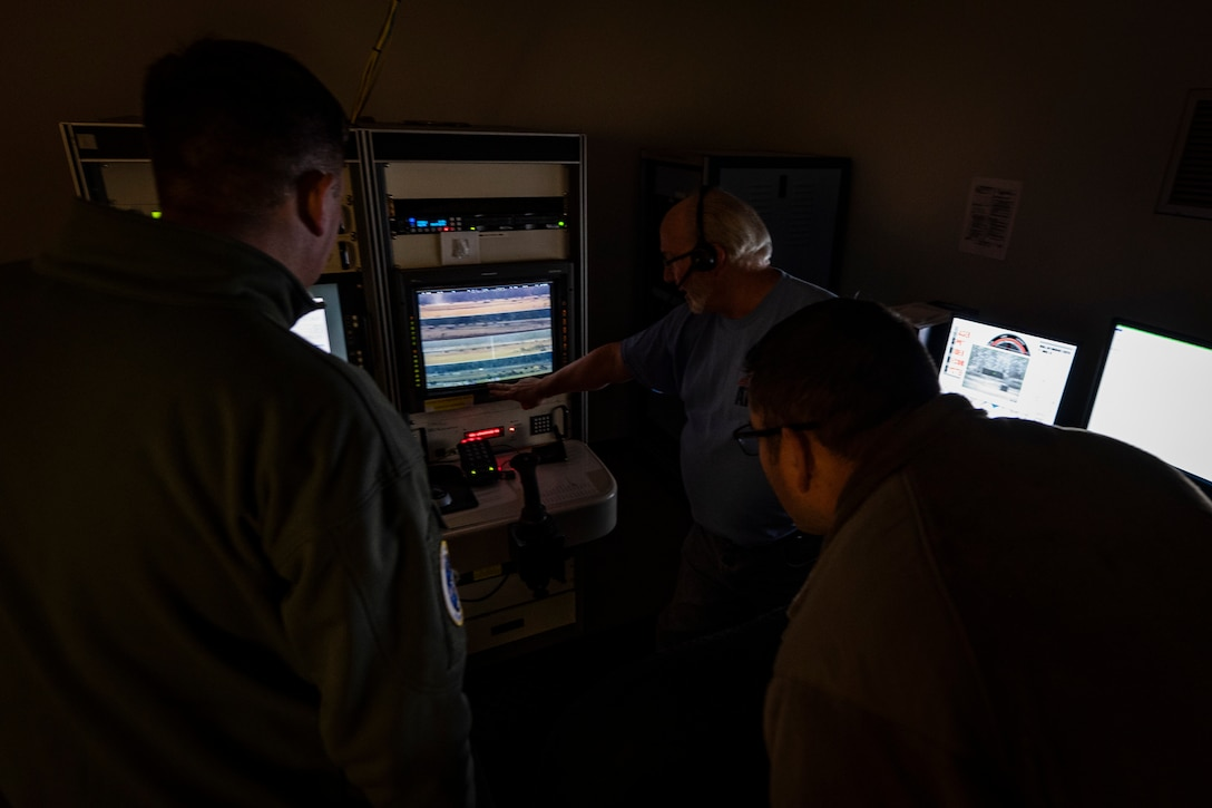 A photo of David Kilmer showing 23d Wing leadership around the scoring room during a 23d OSS immersion
