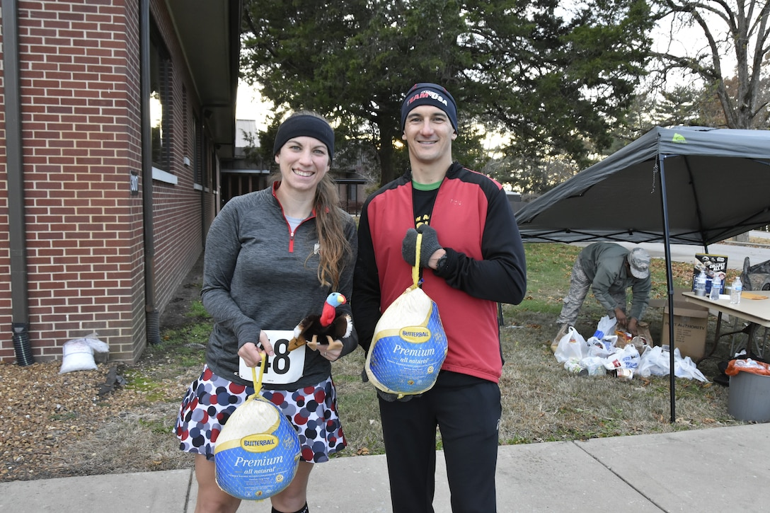 Capt. Elizabeth Sewell and AEDC Commander Col. Jeffery Geraghty show off the turkeys they took home for being the first in their respective divisions to cross the finish line at the 34th Annual AEDC Turkey Trot. The 5K and was held Nov. 15 at the Arnold Lakeside Center, Arnold Air Force Base. Sewell was the first female runner to complete the race with a time of 22 minutes 24 seconds, and Geraghty finished first among male runners with a time of 17 minutes 33 seconds. (U.S. Air Force photo by Bradley Hicks)