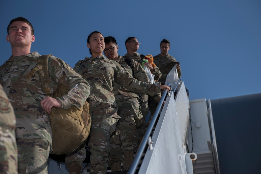 U.S. Air Force Airmen depart a KC-10 Extender Nov. 21, 2019, at Travis Air Force Base, California. The KC-10 returned to Travis AFB for the holidays after supporting operations in Southwest Asia for two months. (U.S. Air Force photo by Airman 1st Class Cameron Otte)