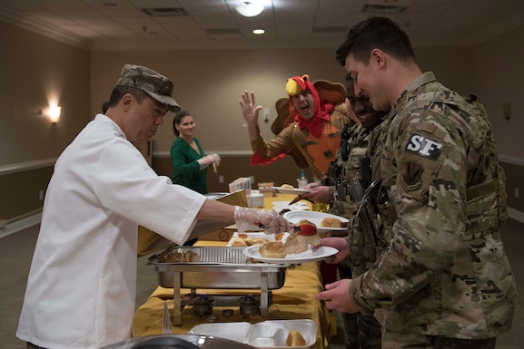 Col. Donn Yates, 4th Fighter Wing commander, serves food during the base's annual Thanksgiving feast, Nov. 28, 2019, at Seymour Johnson Air Force Base, N.C. Leadership from Team Seymour helped serve more than 350 attendees. (U.S. Air Force photo by Senior Airman Victoria Boyton)