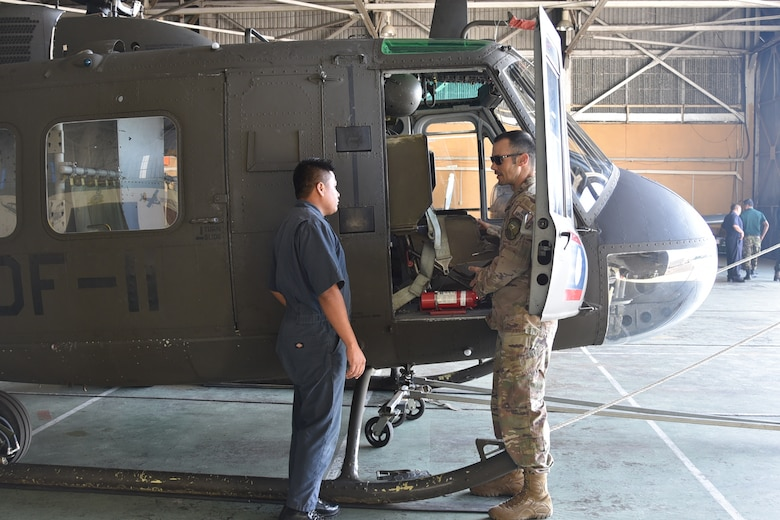 Master Sgt. Raphael Romero, 571st Mobility Support Advisory Squadron aircraft maintenance senior air advisor, instructs a Belizean Defense Force airman on pre-flight inspection at Ladyville, Belize. The MSAS's training focused on aiding the BDF-AW to increase their capacity to conduct air mobility and transportation operations to improve humanitarian, disaster relief and regional stability operations. (Courtesy Photo)