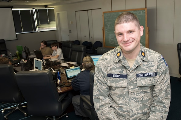 Civil Air Patrol Maj. Jacob Bixler, the Wing Director of Cadet Programs for Virginia Wing, CAP, stands in the conference room at the Winchester Regional Airport, as cadets participate in the CyberPatriot Competition, Oct. 27, 2019.  Bixler is also a technical sergeant in the 167th Airlift Wing, West Virginia Air National Guard, serving as a radio frequency transmissions systems craftsman.