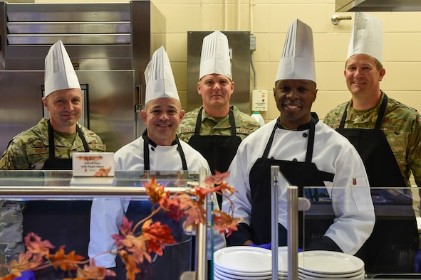 Goodfellow leadership gathers together before serving a Thanksgiving meal at the Western Winds Dining Facility Goodfellow Air Force Base, Texas, Nov. 28, 2019. This tradition is to make sure those who are away from their families still feel like they are a part of one here. (U.S. Air Force photo by Airman 1st Class Zachary Chapman/Released)
