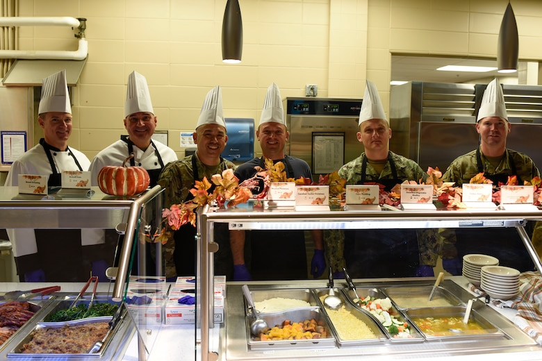 Goodfellow leadership poses before serving a Thanksgiving lunch at the Western Winds Dining Facility Goodfellow Air Force Base, Texas, Nov. 28, 2019. This Thanksgiving meal is a tradition to boost morale for those who cannot spend the day with their families. (U.S. Air Force photo by Airman 1st Class Zachary Chapman/Released)