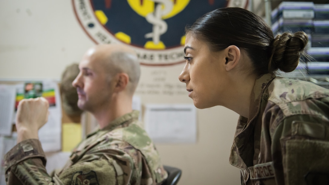 U.S. Air Force Staff Sgt. Courtney Muhl, 386th Air Expeditionary Wing occupational safety NCO-in-charge, looks over online safety records with Tech. Sgt. Joshua Henderson, 386th Expeditionary Medical Group biomedical engineering technician and medical facility manager, at Ali Al Salem Air Base, Kuwait, Nov. 27, 2019. Muhl conducted an annual safety inspection of the clinic ensuring it complied with safety requirements and programs. (U.S. Air Force photo by Tech. Sgt. Daniel Martinez)
