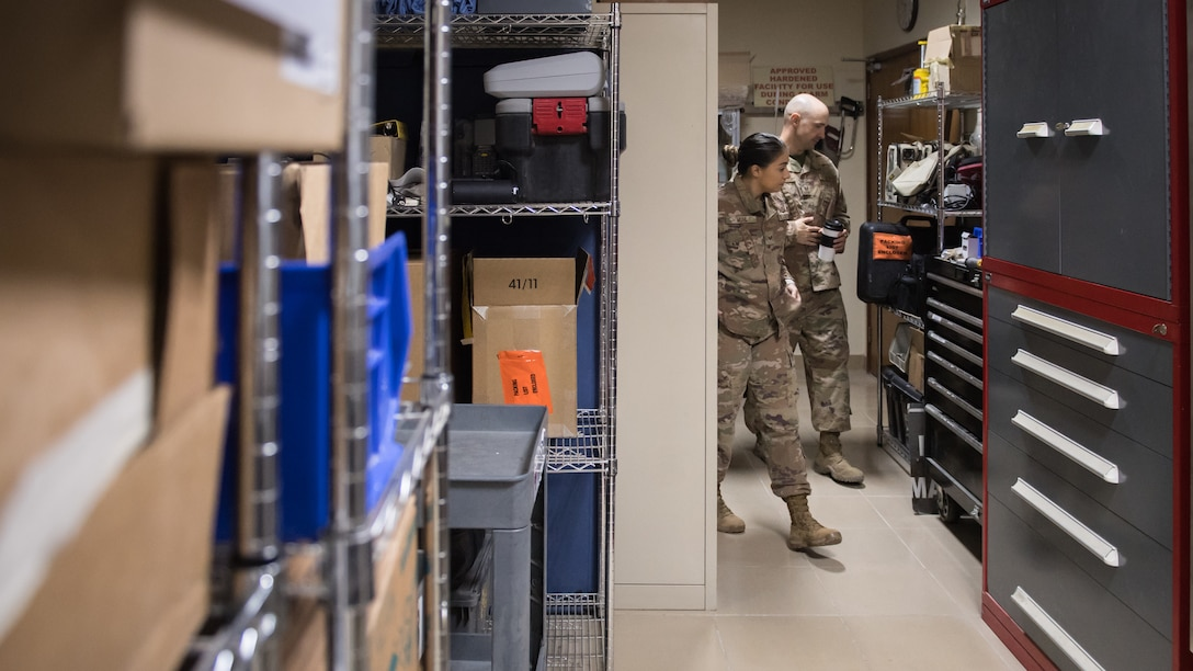 U.S. Air Force Staff Sgt. Courtney Muhl, 386th Air Expeditionary Wing occupational safety NCO-in-charge, performs a safety inspection inside the base clinic with Tech. Sgt. Joshua Henderson, 386th Expeditionary Medical Group biomedical engineering technician and medical facility manager, at Ali Al Salem Air Base, Kuwait, Nov. 27, 2019. Muhl conducted an annual safety inspection of the clinic ensuring it complied with safety requirements, standards and programs. (U.S. Air Force photo by Tech. Sgt. Daniel Martinez)