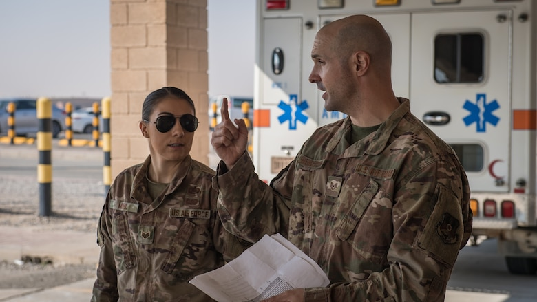 U.S. Air Force Staff Sgt. Courtney Muhl, 386th Air Expeditionary Wing occupational safety NCO-in-charge, performs a safety inspection in the ambulance bay outside the base clinic with Tech. Sgt. Joshua Henderson, 386th Expeditionary Medical Group biomedical engineering technician and medical facility manager, at Ali Al Salem Air Base, Kuwait, Nov. 27, 2019. Muhl conducted an annual safety inspection of the clinic ensuring it complied with safety requirements, standards and programs. (U.S. Air Force photo by Tech. Sgt. Daniel Martinez)