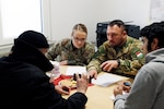 U.S. Army Sgt. Caitlin Thompson, 457th Civil Affairs Battalion, 361st Civil Affairs Brigade, works alongside Hungarian Army Zászlós Ferenc Kapor during Joint Cooperation 2019, an annual civil-military cooperation exercise, involving 24 nations from Europe and North America, Nov. 7, 2019 in Steyerberg, Germany.
