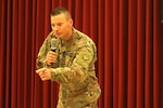 Sgt. Cory Nottingham, behavioral health non-commissioned officer in charge, 1972nd Combat and Operational Stress Control - Medical Detachment, speaks during a Suicide and Behavioral Health Symposium at Camp Arifjan, Kuwait, Nov. 25, 2019. The symposium covered topics such as stress, trauma, detection, and prevention as it relates to mental illness. (U.S. Army Reserve photo by Spc. Dakota Vanidestine)