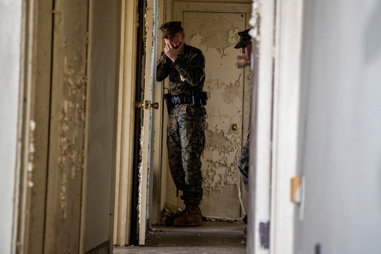 U.S. Marines Corps Lance Cpl. Johnny Olson with Camp Courtney, Provost Marshal Office, Operations, participates in an active shooter training, Camp Foster, Okinawa, Japan, Nov. 26, 2019. Marines with PMO conducted the training to ensure readiness and reliability in the event of an active shooter.