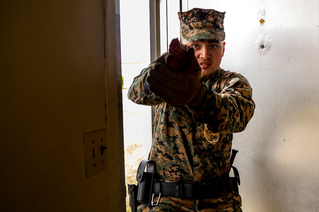 U.S. Marines Corps Lance Cpl. William Anderson with Headquarters and Support Battalion, Provost Marshal Office, Operations, participates in an active shooter, training Camp Foster, Okinawa, Japan, Nov. 26, 2019. Marines with PMO conducted the training to ensure readiness and reliability in the event of an active shooter.