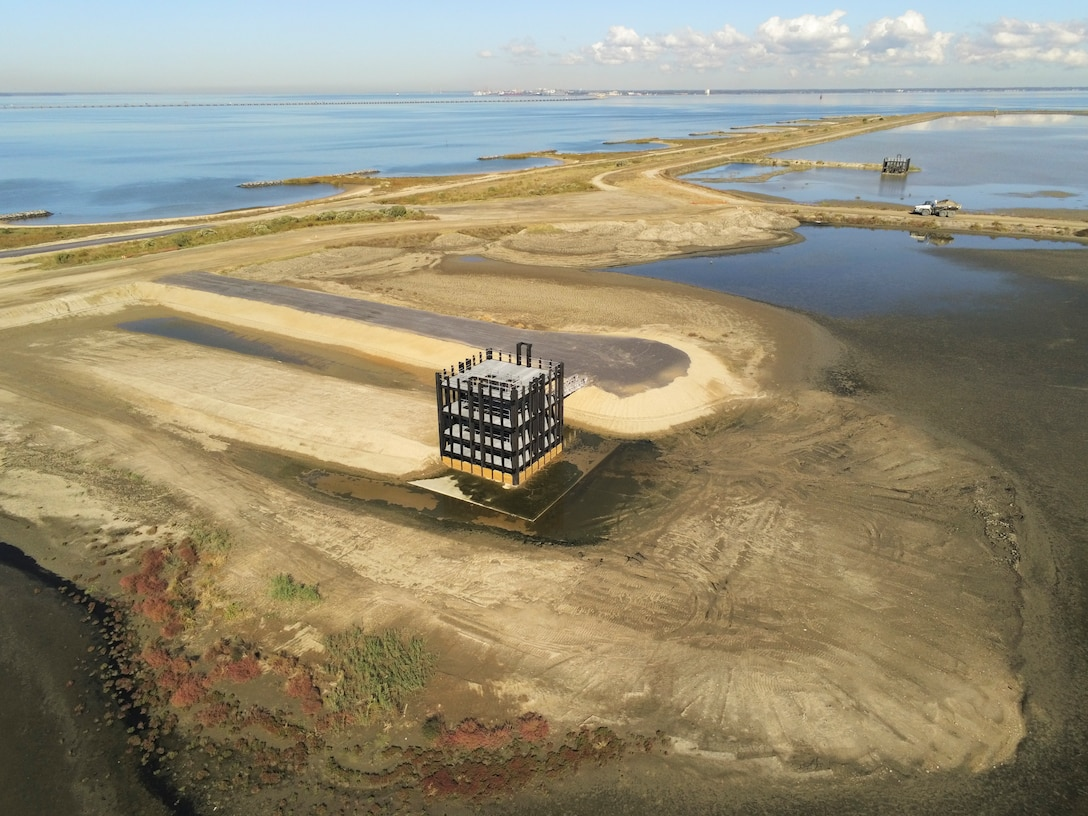 Two recently completed spill boxes at the Craney Island Dredged Material Management Site allows water to return to  the confluence of the James and Elizabeth rivers after moving across the facility from where it was pumped in by dredges to let sediment fall out of the water column. (U.S. Army photo by Patrick Bloodgood)