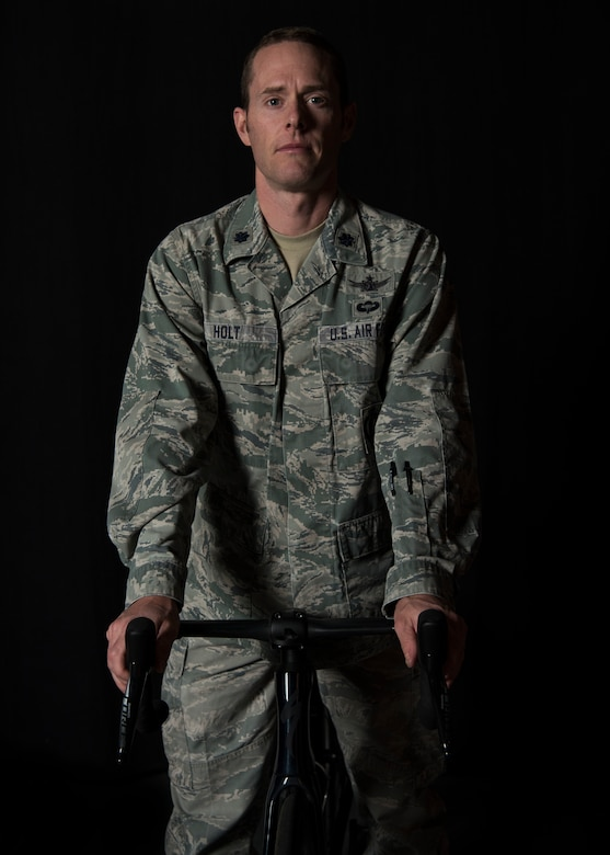 Lt. Col. Ian Holt, 614th Air Operation Center current ops branch chief, poses with his bicycle Nov. 27, 2019 at Vandenberg Air Force Base, Calif. Holt participated in the cycling division during the 2019 Military World Games, which were held Oct. 18–27, 2019 in Wuhan, China. (U.S. Air Force photo by Airman 1st Class Aubree Milks)