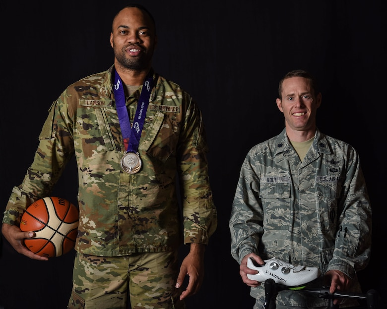 Lt. Col. Ian Holt, 614th Air Operation Center current ops branch chief and Staff Sgt. Jahmal Lawson, 30th Security Forces Squadron mobility equipment custodian, pose for a photo Nov. 27, 2019 at Vandenberg Air Force Base, Calif. Holt and Lawson participated in the 2019 Military World Games Oct. 18–27, 2019 in Wuhan, China; Holt participated in the cycling division and Lawson participated on the U.S. basketball team. Both Airmen represented Vandenberg and the nation at the international event. (U.S. Air Force photo by Airman 1st Class Aubree Milks)