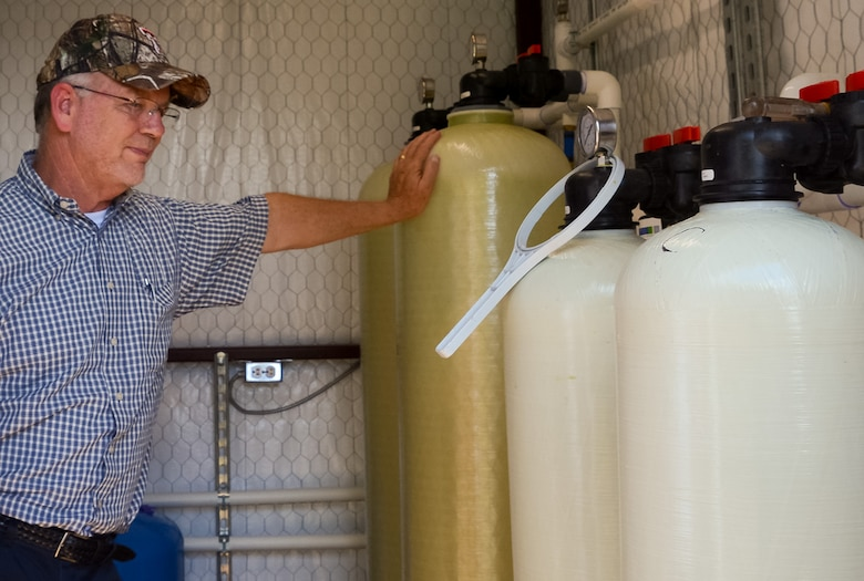 Paul Carroll, a program manager at the Air Force BRAC program, inspects a whole-house treatment system installed at a home near the former Reese Air Force Base in Lubbock, Texas, Aug. 22, 2018. The system is designed to remove PFAS from the home owners drinking water well. (U.S. Air Force courtesy photo)