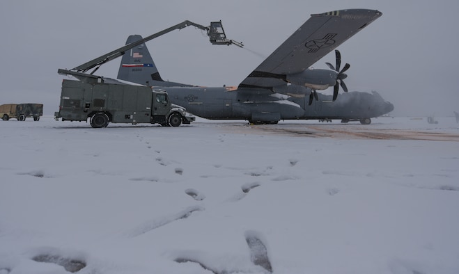Hercules Airmen de-ice aircraft, re-ice each other