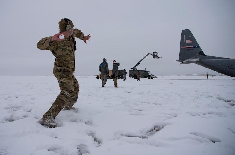 Hercules Airmen de-ice aircraft, re-ice each other