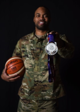 Staff Sgt. Jahmal Lawson, 30th Security Forces Squadron mobility equipment custodian, displays the silver medal he won at the 2019 Military World Games, Nov. 27, 2019 at Vandenberg Air Force Base, Calif. Lawson played on the U.S. basketball team during the Military World Games, which were held Oct. 18–27, 2019 in Wuhan, China. (U.S. Air Force photo by Airman 1st Class Aubree Milks)