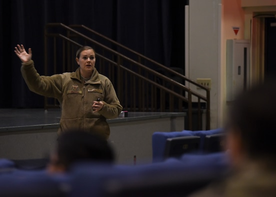 U.S. Air Force Master Sgt. Megan Smith, 8th Fighter Wing Equal Opportunity director, engages with a group of Airmen during the Korea Readiness Orientation about her office's role at Kunsan Air Base, Republic of Korea, Nov. 26, 2019. The EO office supports more than 2,500 Wolf Pack members, both military and civilian. They ensure each service member is treated fairly, regardless of their race, color, religion, national origin, sex, gender identity, sexual orientation, age, genetic information, disability, or prior equal employment opportunity activity. (U.S. Air Force photo by Staff Sgt. Anthony Hetlage)