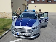 Spc. John Clark with the 1103rd Military Police Detachment - Law & Order works alongside active duty Spc. Barlow patrolling Stuttgart, Germany, June 11, 2017.