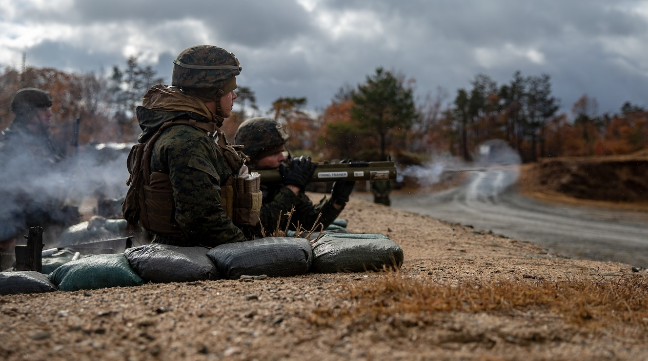U.S. Marines fire training projectiles from an M72 Light Anti-Armor Weapon during Forest Light Middle Army in Aibano Training Area, Shiga, Japan, Dec. 3.