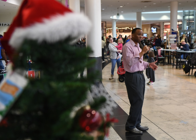 U.S. Air Force Chief Master Sgt. Terrance Smiley, Kisling Noncommissioned Officer Academy commandant, speaks during the Angel Tree Kickoff at Ramstein Air Base, Germany, Dec. 1, 2019. Smiley spoke about the importance of giving back during the holiday season and how it affected him in the past. (U.S. Air Force photo by Staff Sgt. Kirby Turbak)