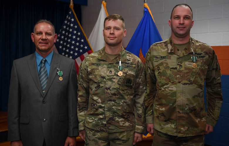 William M. Storrs, Charlie Company, 1st Battalion, 210th Aviation Regiment, 128th Aviation Brigade instructor writer (left), U.S. Army Sgt. 1st Class Daniel Smithey, Charlie Co., 1st Btn., 210th Aviation Regiment, 128th Aviation Brigade avionic mechanic instructor (center), and Staff Sgt. Dennis S. Kay, Bravo Co., 2nd Bte., 210th Aviation Regiment, 128th Aviation Bde. instructor writer (right), pose for a photo during the Instructor of the Year ceremony at Joint Base Langley-Eustis, Virginia, Nov. 21, 2019.