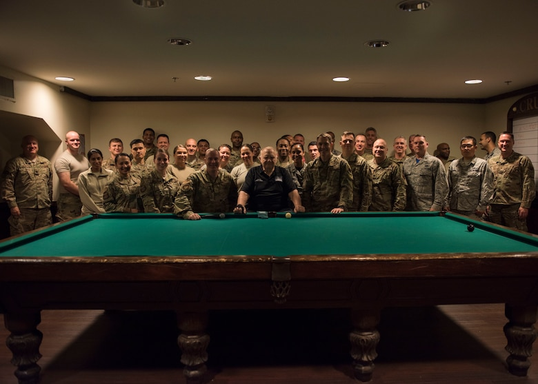 Participants pose for a photo during a crud tournament at Joint Base Langley-Eustis, Virginia, Nov. 15, 2019. Crud is a game that originated in the Royal Canadian Air Force. (U.S. Air Force photo by Airman 1st Class Sarah Dowe)