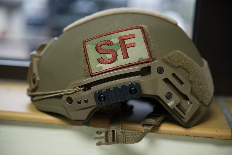 A U.S. Air Force 422nd Security Forces Squadron ballistic helmet lays on the table during a recall exercise at RAF Croughton, England, November 21, 2019. U.S. Air Forces in Europe-Air Forces Africa provided 422nd SFS members with the latest helmet protection to improve hearing and communication with a specially-designed frame, lessen fatigue with a balanced and lighter helmet, and improve capability to hold night-vision goggles. (U.S. Air Force photo by Airman 1st Class Jennifer Zima)