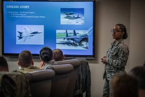 Tech. Sgt. Brandy Brown, religious affairs Airman, 932nd Airlift Wing Chaplain's Office, shares her Airman's Story with Wing leadership during the the Wing Review meeting, Nov. 15, 2019. Each month before the unit training assembly a Citizen Airman shares some facts about their Air Force career,  civilian life, and goals within the Air Force Reserve. (U.S. Air Force photo by Christopher Parr)
