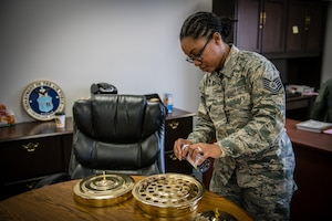 Tech. Sgt. Brandy Brown, religious affairs Airman, 932nd Airlift Wing Chaplain's Office, prepares sacrament for a church service held at the 932nd Airlift Wing Maintenance Group building, Chaplain's satellite office, Nov. 16, 2019, Scott Air Force Base, Illinois. The biggest job of a chaplain's assistant is religious accommodation. Chaplain's assistants play an important role in the well-being of the Airmen, from being available during personal matters to managing important ceremonies in the lives of the Airmen.  (U.S. Air Force photo by Christopher Parr)