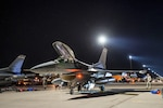 """U.S. Air Force Maj. Mathew """"Chaff"""" Crabb,  pilot, 120th Fighter Squadron, 140th Wing, Colorado Air National Guard, Buckley Air Force Base, Colorado, prepares his aircraft prior to a night training mission during Red Flag 17-2 at Nellis Air Force Base, Nevada March 1, 2017. The Red Flag Exercise is a realistic combat training exercise involving the air forces of the United States, its allies, and coalition partners, and is conducted on the vast gunnery ranges of the 2.9M acre Nevada Test and Training Range, a primary training area associated with Nellis AFB. The exercise brings in more than 100 aircraft and 3,000 personnel with the goal of preparing commanders and service members at all levels for war in a realistic training scenario. (U.S. Air National Guard photo by Senior Master Sgt. John Rohrer)"""