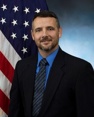 official photo with blue background and American flag