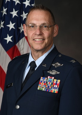 Col Robert McCoy official photo with American flag background