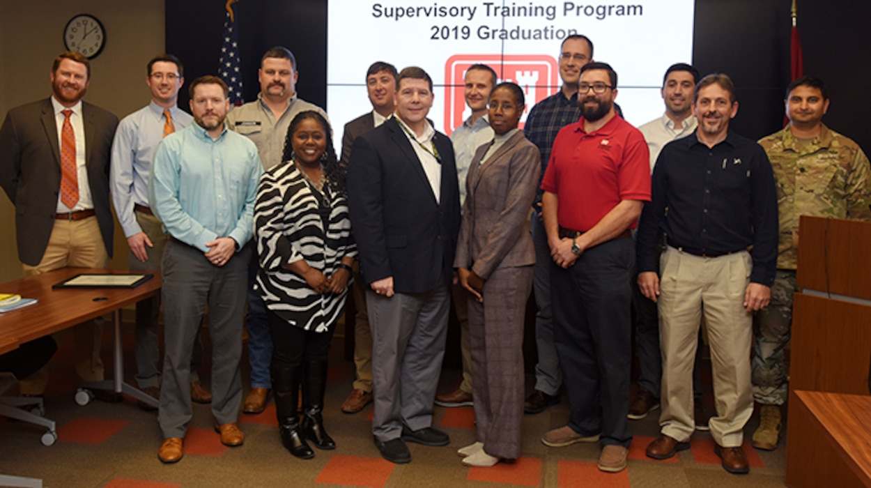 The U.S. Army Corps of Engineers Nashville District's 2019 Supervisory Training Program class graduated during a ceremony Dec. 3, 2019 at the district's headquarters in Nashville, Tenn. STP is a nine-month program where the participants share experiences and learn the core skills required to successfully manage the workforce and develop as a leader. From left to right are Frank Mills, Dylan Grissom, Myles Barton, Ryan Johnson, Stephanie Coleman, Bryan Mangrum, Chris Marshall, Kayl Kite, Cynthia Lightner, William Terry, David Bogema, Ryan Frye, Gerald Lee, and Lt. Col. Sonny B. Avichal, Nashville District commander. Graduates not pictured include Jamie James, Jason Phillips and Isaac Taylor. (USACE photo by Lee Roberts)
