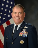 Col Patrick O'Sullivan official photo with American flag background