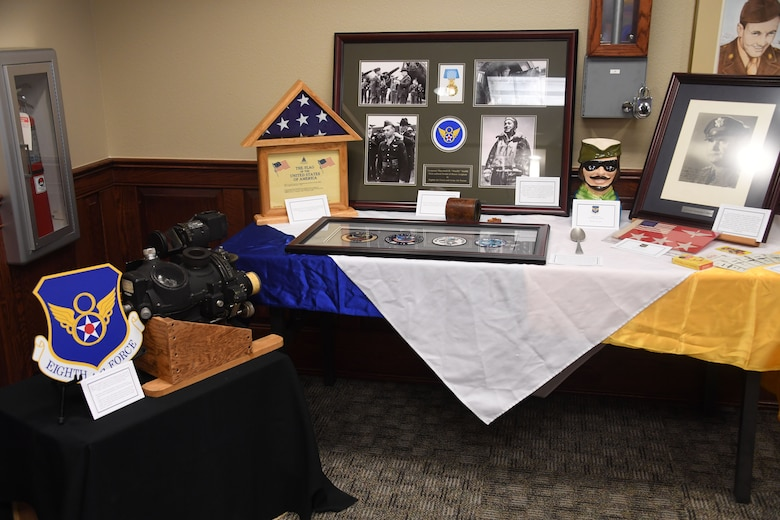 Eighth Air Force artifacts are displayed during the first 8th Air Force, J-GSOC Spouses' Orientation, Nov. 18, 2019. The Toby Mug, historic patches and memorabilia are preserved by the 8th Air Force historian. More than 30 military spouses received an immersion briefing, toured the different J-GSOC work centers and visited with local leadership during the event.