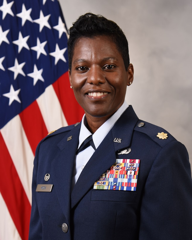 Maj Karen Mock official photo with American flag background