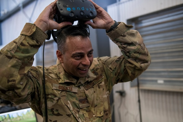 Col. Sanjay A. Gogate, 27th Special Operations Medical Group commander, removes the Enduvo virtual reality system during the Medic Rodeo at Cannon Air Force Base, N.M., Sept. 17, 2019. Over 100 medical Airmen tried out the Enduvo system at the Medic Rodeo, using a variety of scenarios. (U.S. Air Force photo by Senior Airman Vernon R. Walter III)