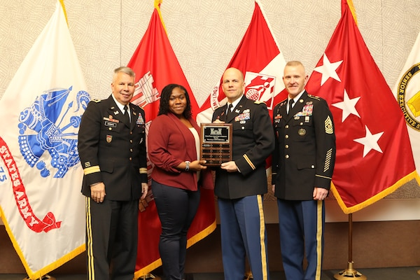 On behalf of the Detroit District,  Lt. Col. Greg Turner (center) and Michelle Williams, LRD small business deputy; receive a Small Business award from Lt. Gen. Todd Semonite, chief of engineers; (left) and Sgt. Major Bradley Houston, command sergeant major (right) during the Small Business Conference in Dallas, Texas.