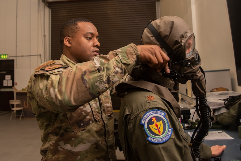 Tech. Sgt. Damron Crump, 100th Operations Support Squadron aircrew flight equipment craftsman, fits Maj. Joe Schmitt, 351st Air Refueling Squadron pilot, for chemical gear at RAF Mildenhall, England, Dec. 3, 2019. Aircrew members receive a set of chemical protection gear to wear on missions in environments vulnerable to chemical attack. (U.S. Air Force photo by Airman 1st Class Joseph Barron)