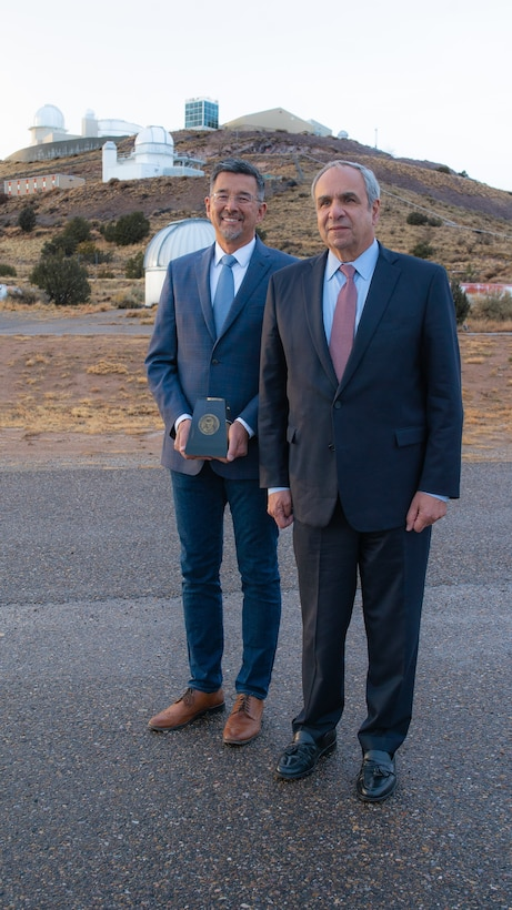 Left to Right: Air Force Research Laboratory 2018 Harold Brown Award winner Dr. Robert Johnson and Dr. Richard Joseph Chief Scientist of the Air Force stand in front of AFRL's Starfire Optical Range telescopes following the award presentation ceremony on Nov. 21, 2019. (U.S. Air Force photo/ Macee Hunt)