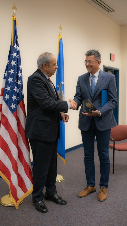 Dr. Richard Joseph Chief Scientist of the Air Force presents Air Force Research Laboratory scientist Dr. Robert Johnson the 2018 Harold Brown Award in a ceremony at AFRL's Starfire Optical Range on Nov. 21, 2019. (U.S. Air Force photo/ Macee Hunt)