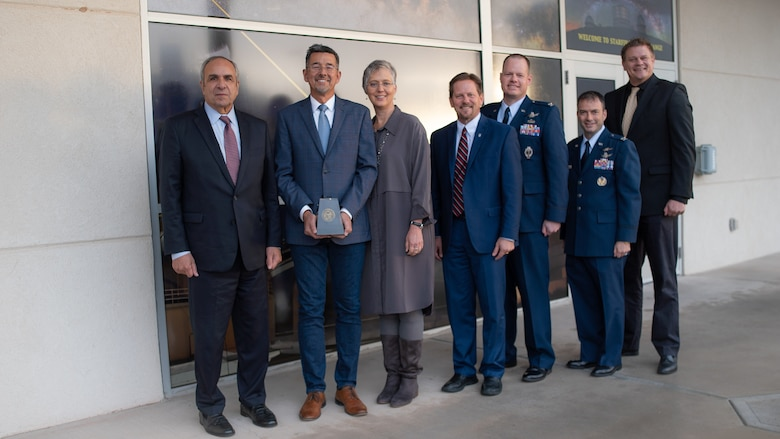 Left to Right: Dr. Richard Joseph Chief Scientist of the Air Force; Dr. Robert Johnson 2018 Harold Brown Award winner; Dr. Bethany Kolb wife of Dr. Johnson; Dr. Kelly Hammett AFRL Directed Energy director; Col. Joseph Roth AFRL Space Electro-Optics division chief; Col. Mario Serna Military Assistant to the Air Force Chief Scientist; and Dr. Darrell Lochtefeld Special Assistant to the Air Force Chief Scientist following the awards ceremony on Nov. 21, 2019. (U.S. Air Force photo/ Macee Hunt)