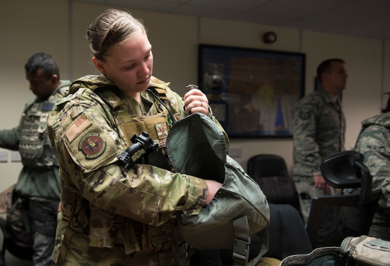 U.S. Air Force Staff Sgt. Nichole Sehle, 422nd Security Forces Squadron NCOIC of standardization and evaluations, locates required equipment during a recall exercise at RAF Croughton, England, November 21, 2019. Quarterly recall exercises are a form of readiness for defenders to always be prepared to respond at a moment's notice. (U.S. Air Force photo by Airman 1st Class Jennifer Zima)